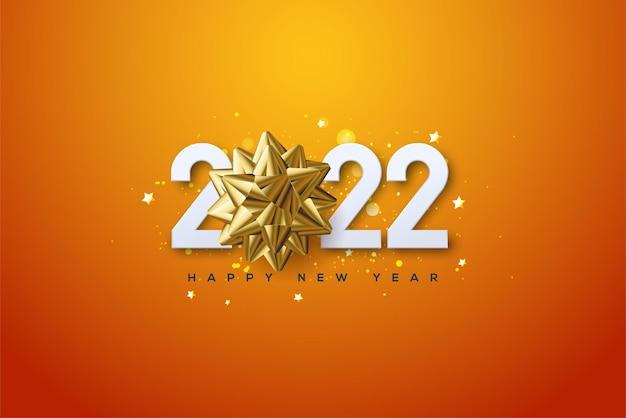 2022 gelukkig nieuwjaar met een gouden lintje boven het cijfer 0