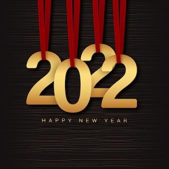 2022 gelukkig nieuwjaar nieuwjaarskaart met gouden letters die aan rode linten hangen