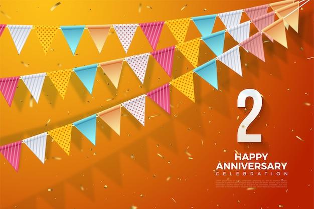 2de verjaardag met het nummer aan de rechterkant en de kleurrijke vlag erop.