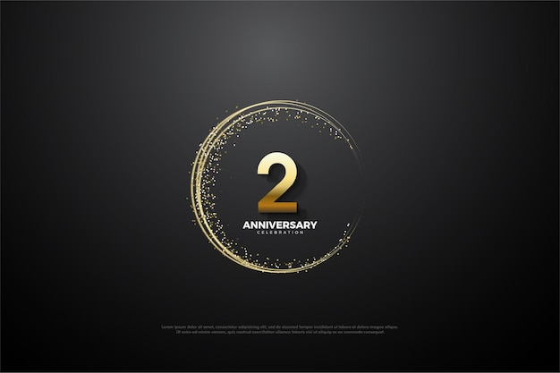 2e verjaardag achtergrond met cijfers en goudkleurig zand die een onvolmaakte cirkel vormen.