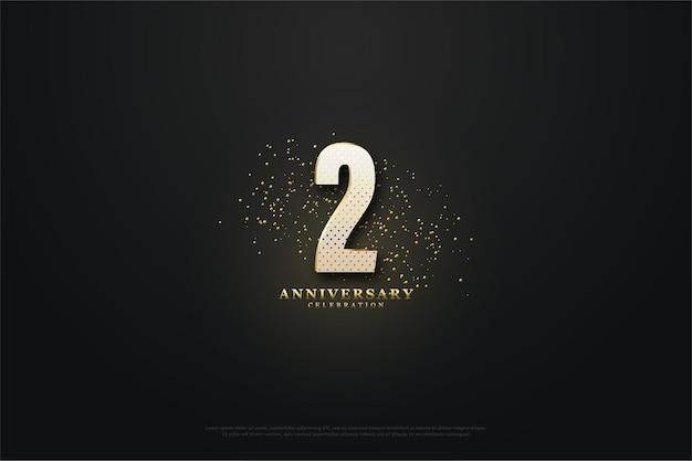 2e verjaardag achtergrond met gouden cijfers en glitters