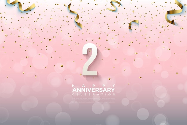 2e verjaardag met gearceerde nummers bedekt met gouden linten.