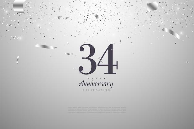 34e verjaardag met cijfers op een zilveren achtergrond
