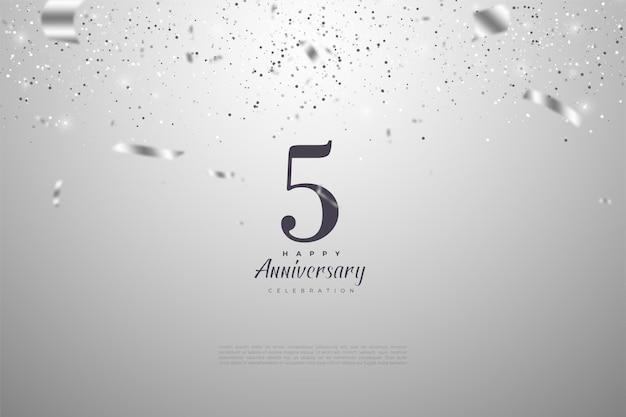 5e verjaardag met cijfers en zilveren lintregen.