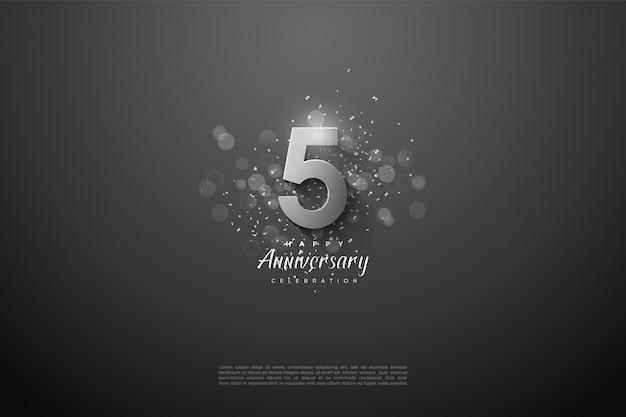 5e verjaardag met zilveren cijfers op zwarte achtergrond.