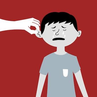 Aan het oor trekkende jongen huilt kindermishandeling