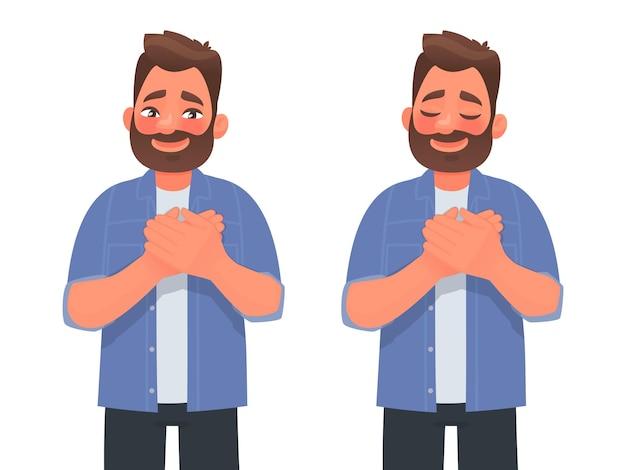 Aangeraakte positieve man houdt zijn handen op zijn borst en drukt dankbaarheid uit