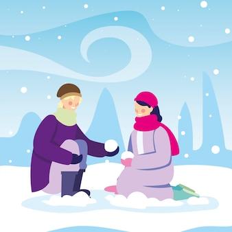 Aantal mensen met winterkleren in landschap met sneeuwval