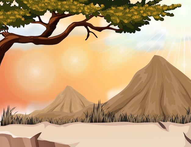 Aardscène met berg en boom