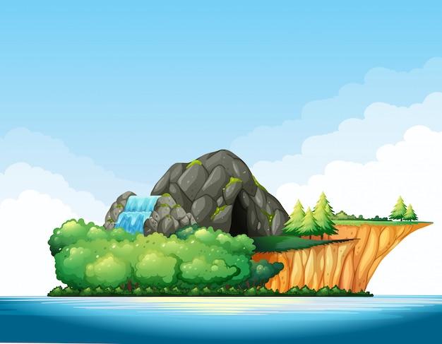 Aardscène met grot en waterval op het eiland