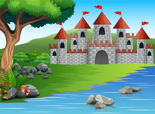 Aardscène met kasteel en een vijver