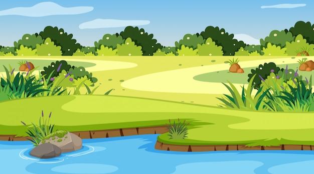 Aardscène met rivier in het park