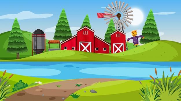 Aardscène met rode schuur op de landbouwgrond