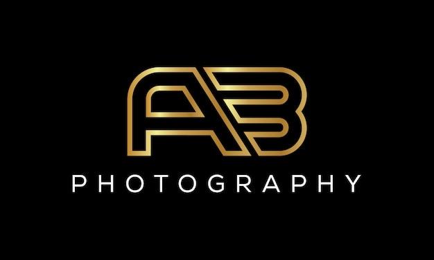 Ab artistieke borstel brief logo met de hand geschreven in gouden kleur vectorillustratie
