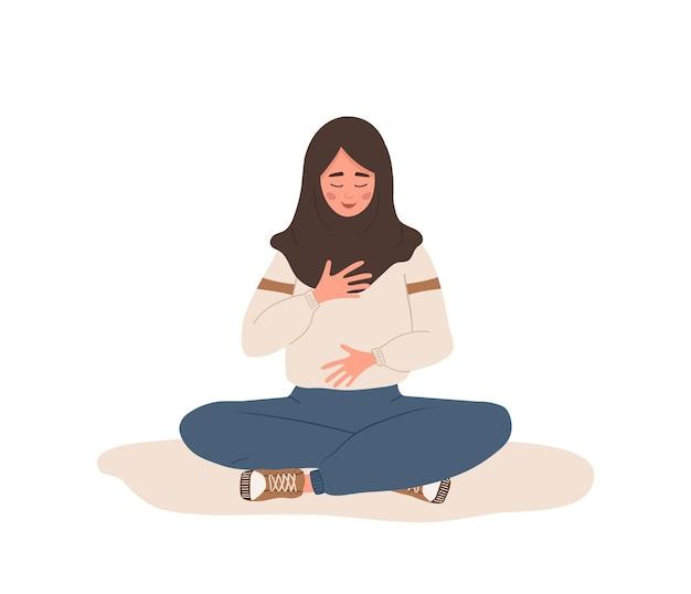 Abdominale ademhaling. arabische vrouw die buikademhaling beoefent voor ontspanning.