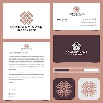 Abstract bloemenmandala-logo premium vector en visitekaartje