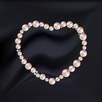 Abstract hartframe van roze parels op zwarte zijde