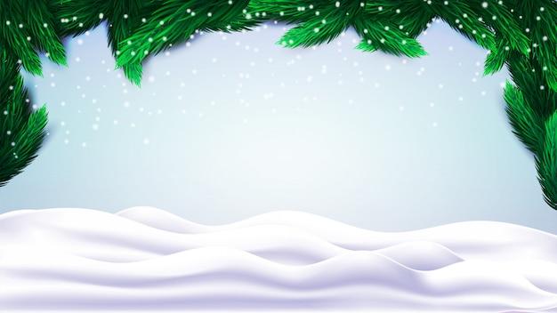 Abstract kerstmislandschap met sparrentakken en sneeuwheuvels.