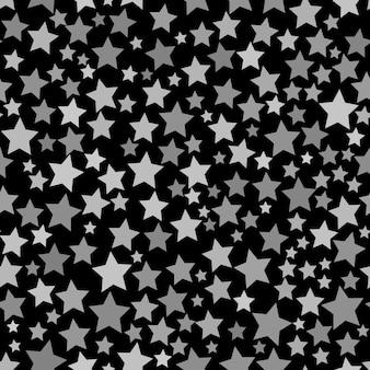 Abstract naadloos patroon van sterren van verschillende grootte in zwarte en grijze kleuren