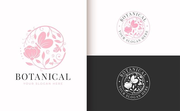 Abstract roze bloemen vintage logo met vlinder