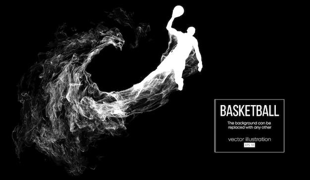Abstract silhouet van een basketbalspeler op donkere zwarte achtergrond van deeltjes, stof, rook, stoom. basketbalspeler springen en voert slam dunk.