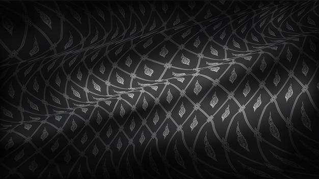 Abstract traditioneel thais patroon, op realistische rip curl zwarte zijde stof achtergrond.