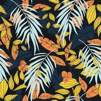Abstract trend naadloos patroon met kleurrijke tropische bladeren en planten op zwarte achtergrond