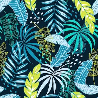 Abstract tropisch naadloos patroon met blauwe en groene bloemen en planten