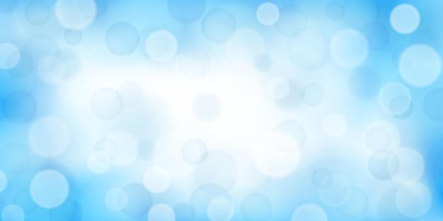 Abstracte achtergrond met bokeh-effecten in lichtblauwe kleuren