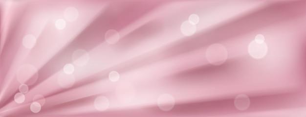 Abstracte achtergrond met radiale stralen of plooien en bokeh-effecten in roze kleuren
