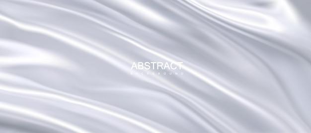 Abstracte achtergrond met zijdeachtige gedrapeerde witte stof