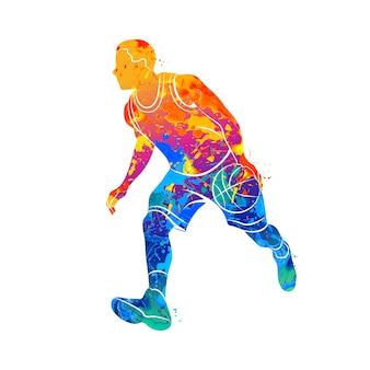 Abstracte basketbalspeler met bal van splash van aquarellen.