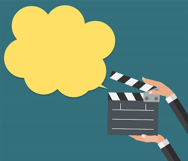 Abstracte bioscoop klepel met tekstballon platte symboolpictogram. vec