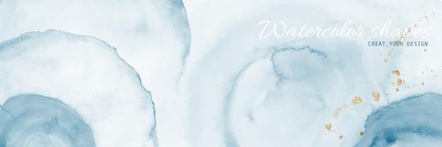 Abstracte cirkelvormen van blauwe en plons gouden waterverf.