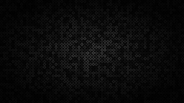 Abstracte donkere achtergrond van kleine ringen in de kleuren zwart en grijs.
