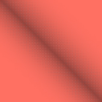 Abstracte halftone puntenachtergrond in koraalkleur