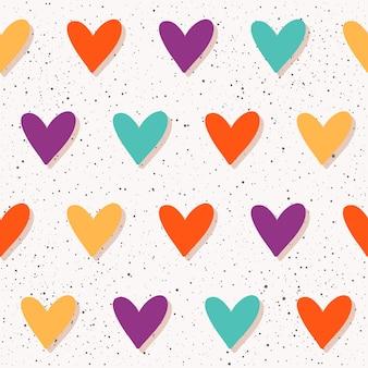 Abstracte naadloze patroonachtergrond. handgemaakt hartpatroon voor ontwerpkaart, uitnodiging, t-shirt, boek, spandoek, poster, plakboek, album, textielstof, kledingstuk, tasafdruk enz.