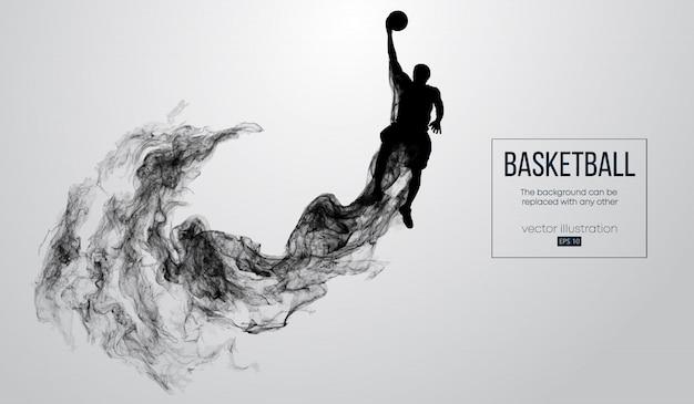 Abstracte silhouet van een basketbalspeler op witte achtergrond van deeltjes, stof, rook, stoom. basketbalspeler springen en voert slam dunk.