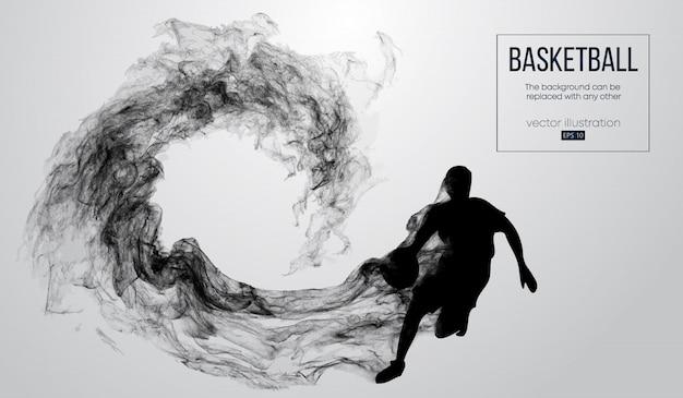 Abstracte silhouet van een basketbalspeler op witte achtergrond van deeltjes, stof, rook, stoom. de basketbalspeler wordt uitgevoerd.