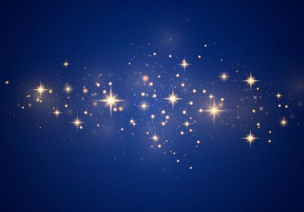 Abstracte stijlvolle lichteffect op een blauwe achtergrond. gele stofgele vonken en gouden sterren schijnen met speciaal licht. luxe schittert sprankelende magische stofdeeltjes.