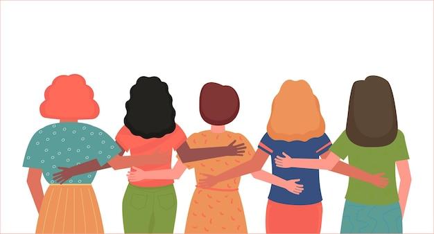 Achteraanzicht van meisjes van verschillende nationaliteiten, jonge vrouwen die samen staan en elkaar knuffelen.