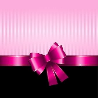Achtergrond gift met roze lint ideaal voor valentijnsdag