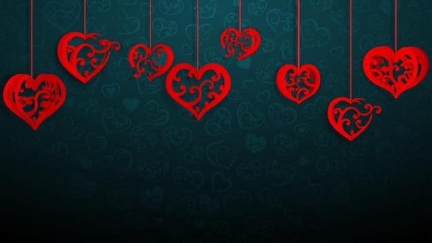 Achtergrond met hangende papieren volumeharten met krullen, rood op donkerblauw