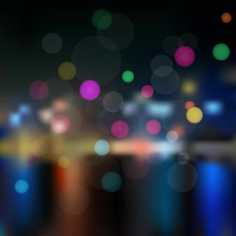 Achtergrond met het uitzicht op de nachtstad onscherp