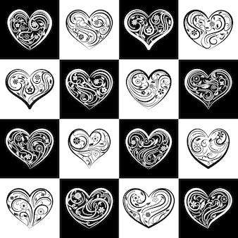 Achtergrond of naadloos patroon van harten met ornament van krullen, bloemen en bladeren, op zwarte en witte vierkanten