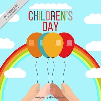 Achtergrond van de dag regenboog en ballonnen voor de kinderen