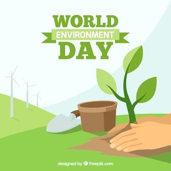 Achtergrond van de handen met installatie voor dag wereld milieu