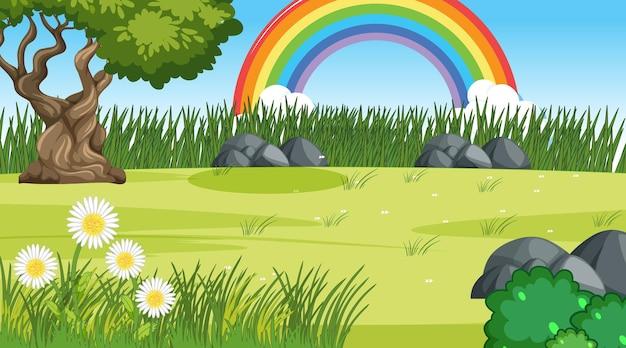 Achtergrond van de natuurscène met regenboog in de lucht