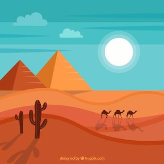 Achtergrond van de piramides van egypte landschap met caravan van kamelen