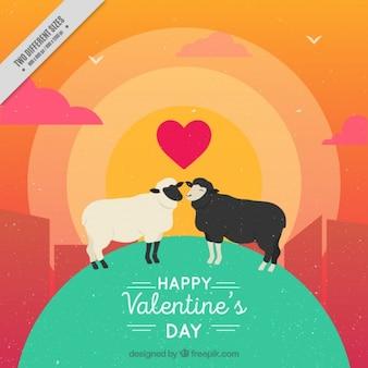 Achtergrond van de weide bij zonsondergang met schapen in de liefde